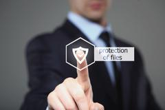 Technology and internet concept - businessman pressing security button on Stock Photos