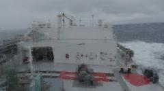 Deck of LPG tanker, at stormy sea, raining. Stock Footage