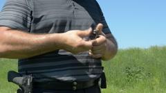 Man charging a handgun gun Stock Footage