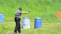 Man shoot with a gun in targets on shooting range. Stock Footage