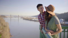 Couple Enjoy View Of River From St Johns Bridge, Man Kisses Girlfriend Stock Footage