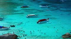 People and tourist modern speed boats in idealistic tropical blue sea lagoon Stock Footage