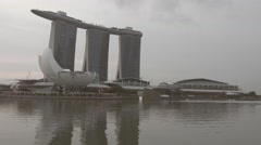 Marina Bay water and Marina Bay sands building with ArtScience Museum Stock Footage