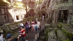 Tourists visiting Ta Prohm Ruins in Cambodia. UHD video Stock Footage