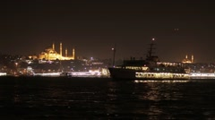Night view of Istanbul from Bosphorus with boats and Mosques Stock Footage