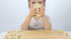 Little girl kneading dough Stock Footage