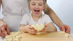 Little girl playing with raw dough Stock Footage