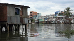 Polluted water, riverside homes, poverty in suburbs of Saigon, Vietnam Stock Footage