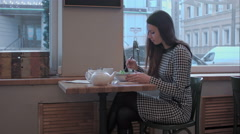 portrait of eating salad in restaurant beautiful young woman - stock footage