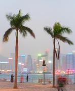 People at embankment at twilight in Hong Kong - stock photo