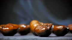 Fried coffee beans with smoke. Close up. Stock Footage