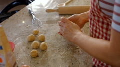 Woman forming balls with dough Stock Footage