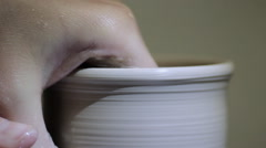 Potter Creates the Product on a Potter's Wheel - stock footage