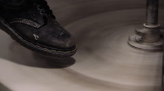Foot of Potter Spinning Potter's Wheel Stock Footage