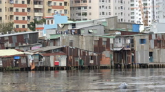 Slum housing contrasts with modern apartment buildings in Saigon, Vietnam, Asia - stock footage