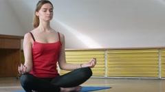 Yoga girl in lotus pose Stock Footage
