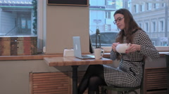 business lady in glasses pondering over in cafe - stock footage