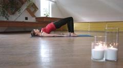 Yoga girl performing bridge exercise Stock Footage