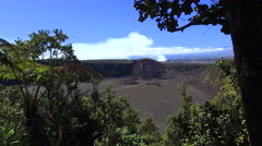 Barren volcano crater, with blue sky background - Hawaii, slider shot - stock footage