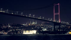 Night View of Bosphorus Bridge from a boat in Istanbul Turkey Stock Footage