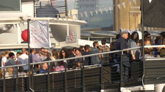 Tourists gathered on a boat's deck in London Stock Footage