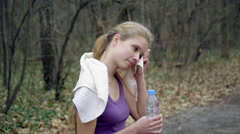 Woman runner is jogging on forest path in  park Stock Footage