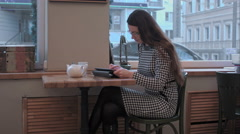 Business woman use Tablet in the morning at restaurant while waiter service her Stock Footage