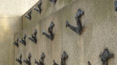 Little anchors on a wall in London Stock Footage