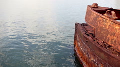 Locked down shot of shipwreck sinking in the sea. Bow boat. Stock Footage