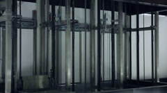 In the Elevator Shaft of View. a Cage Arrives at the Floor Stock Footage