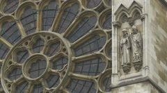 Close up view of Big Ben with rosette and sculptures in London Stock Footage