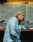 Miserable woman in a betting shop Stock Photos