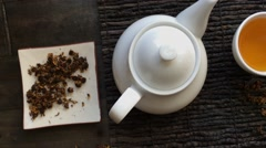 Chinese tea and white kettle from above Stock Footage