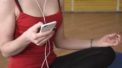 Yoga girl listening misic Stock Footage