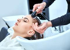 shampoo for hair, beauty salon, hair wash - stock photo