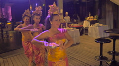 Three traditional Balinese dancers performing in Bali at a night club Stock Footage