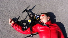 4K, Pretty woman attacked by drone quadrocopter with bleeding head injuries - stock footage