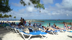 people in tropical beach - Coco Cay, Bahamas - stock footage