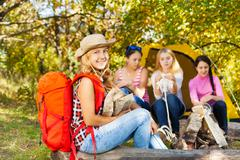 Happy beautiful girl with red rucksack sitting Stock Photos