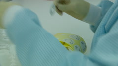 Women in Rubber Gloves Marks Labels Ready-Made Products. Close up - stock footage