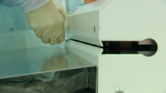 Man in Rubber Gloves Packs in Vacuum in the Machine. Close up Stock Footage