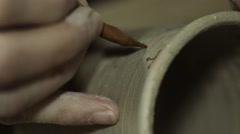 Artist Painting on a Ceramic Plate Stock Footage