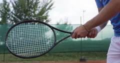 Tennis Player Nervously Spins The Racket And Misses The Ball - stock footage