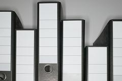 Ring binders arranged liked a graph - stock photo