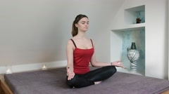 Young female meditating in lotus position Stock Footage