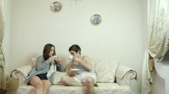 Man and woman drinking tea (coffee) in the living room. Stock Footage