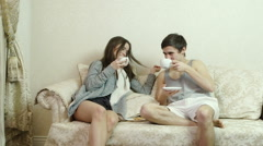 Lovely couple drinking tea while sitting on the sofa. Stock Footage