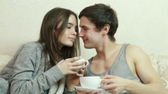 Loving couple with cups in their hands flirting with each other. Stock Footage