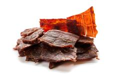 Beef jerky isolated on a white studio background Stock Photos