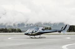 Single-engine Helicopter on platform before launch - stock photo
